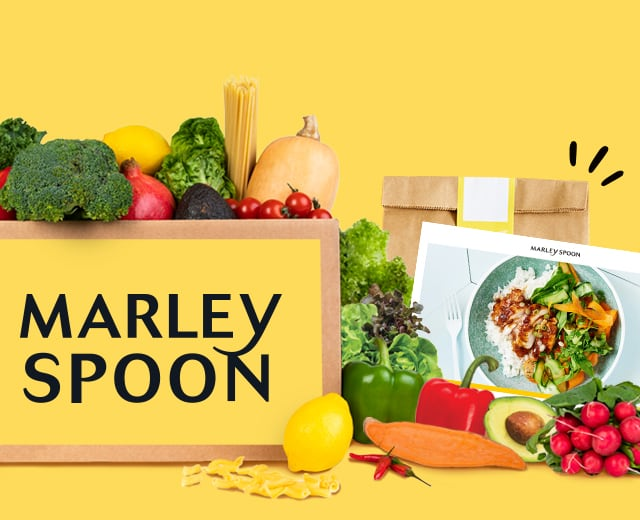 Family with a Marley Spoon meal kit filled with fresh ingredients and 3 cooked dishes